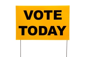 "Yellow Yard Sign With ""vote Today"" On It"